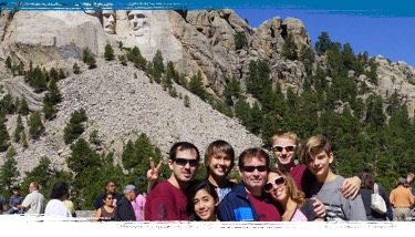 ASSE Exchange Student with Host Family in front of Mt. Rushmore
